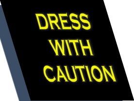 slanted sign with the words DRESS WITH CAUTION