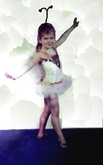 Sarine Voltage at 3 years old in lonesome little butterfly costume complete with with wings and golden ballet slippers